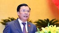Bộ trưởng Bộ Tài chính Đinh Tiến Dũng phát biểu tại phiên họp Quốc hội chiều 22/10. Ảnh: Cổng thông tin Quốc hội