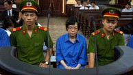 Huỳnh Thị Huyền Như (SN 1978, quyền Trưởng phòng Giao dịch Điện Biên Phủ, Vietinbank TPHCM) tại một phiên toà.