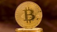 Bitcoin tăng vượt mốc 7.000 USD