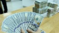 Tỷ giá trung tâm giảm 2 đồng. Ảnh: BNEWS/TTXVN
