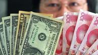 Trong vòng 1 năm trở lại đây, đồng Nhân dân tệ đã giảm giá hơn 4% o với đồng USD - Ảnh: China Daily.