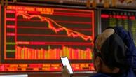 Nhà đầu tư tại một công ty môi giới chứng khoán ở Bắc Kinh (Trung Quốc). Ảnh:Reuters