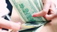 Tỷ giá trung tâm giảm 5 đồng. Ảnh minh họa: TTXVN