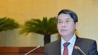 Chủ nhiệm Uỷ ban Tài chính - Ngân sách Nguyễn Đức Hải trình bày báo cáo thẩm tra dự án Luật Quản lý nợ công (sửa đổi).