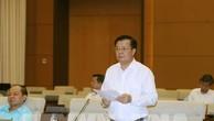 Bộ trưởng Bộ Tài chính Đinh Tiến Dũng giải trình ý kiến của các đại biểu. Ảnh: TTXVN