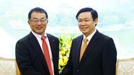 Phó Thủ tướng Vương Đình Huệ và ông Keisuke Nishimura, Phó Chủ tịch điều hành, Thành viên cao cấp Hội đồng quản trị Tập đoàn Kirin. Ảnh: VGP