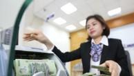 Giá USD sáng 21/9 tại các ngân hàng thương mại tiếp tục ổn định. Ảnh: BNEWS