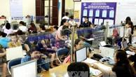 Nhiều doanh nghiệp ở Hà Nội chủ động nộp tiền nợ đọng bảo hiểm sau thanh tra. Ảnh: TTXVN