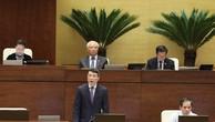 Thống đốc NHNN Lê Minh Hưng trả lời chất vấn trước Quốc hội. Ảnh: VGP