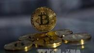 Đồng tiền Bitcoin tại London, Anh. Ảnh: AFP/TTXVN