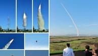 Nhà lãnh đạo Triều Tiên Kim Jong-un và các quan chức quân đội theo dõi một vụ thử hệ thống phòng không mới gần đây. (Ảnh: Yonhap)