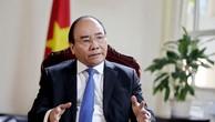 Thủ tướng Chính phủ Nguyễn Xuân Phúc trả lờiphỏng vấn hãng tin Bloomberg. Ảnh: VGP/Hải Minh