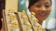 Đôla yếu kéo giá vàng thế giới tăng