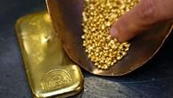 Giá vàng vừa tìm lại mốc 1.300 USD sau hơn 9 tháng. Ảnh:AFP.