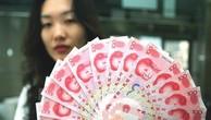 Đồng tiền Nhân dân tệ mệnh giá 100. (Nguồn: AFP/TTXVN)
