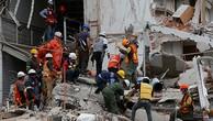 Việc tìm kiếm nạn nhân dưới các toà nhà bị đổ được coi là ưu tiên hàng đầu. Ảnh:Reuters.