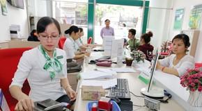 Nhiều ngân hàng vẫn tiếp tục tăng lãi suất huy động để đáp ứng nhu cầu vay vốn cuối năm và dự trữ cho năm tài chính mới. Ảnh: Việt Trần