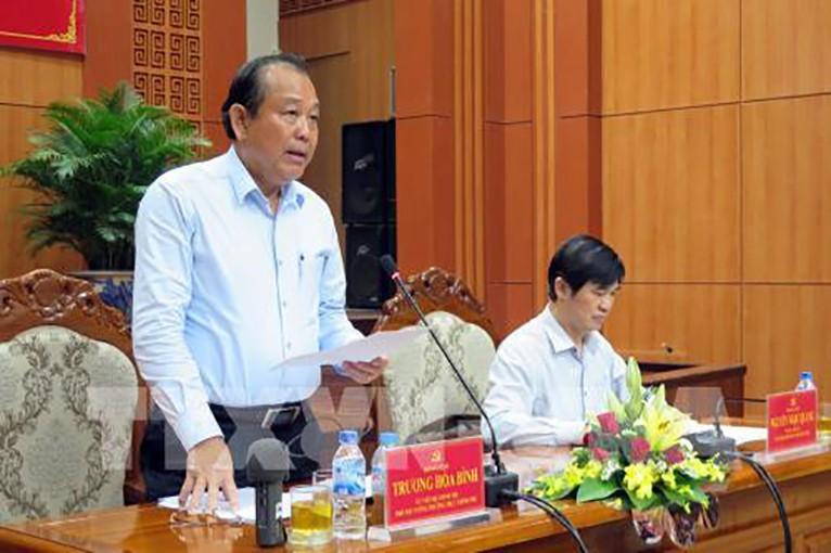Đồng chí Trương Hòa Bình, Ủy viên Bộ Chính trị, Phó Thủ tướng Thường trực Chính phủ làm Trưởng đoàn, làm việc với Ban Thường vụ Tỉnh ủy Quảng Nam về công tác quy hoạch và luân chuyển cán bộ. Ảnh: TTXVN