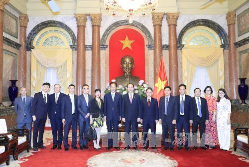 Chủ tịch nước Trần Đại Quang tiếp đoàn đại biểu Hãng thông tấn Tân Hoa xã đang ở thăm và làm việc tại Việt Nam. Ảnh: TTXVN