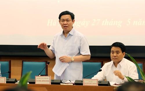 Phó Thủ tướng Vương Đình Huệ làm việc với Thành phố Hà Nội về vấn đề đổi mới cơ chế quản lý, tài chính và tổ chức lại các đơn vị sự nghiệp công. Ảnh: VGP