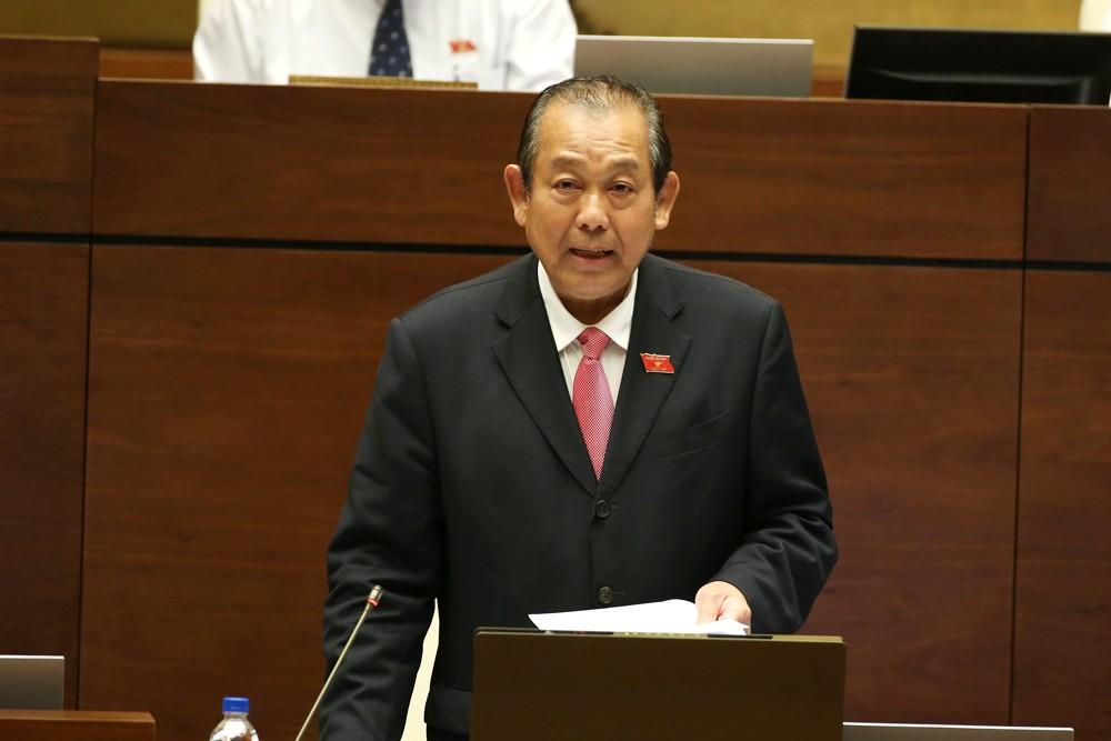 Phó Thủ tướng Trương Hòa Bình trả lời chất vấn của đại biểu Quốc hội. Ảnh: VGP