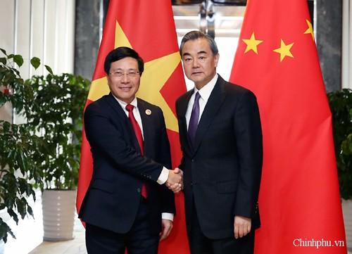 Phó Thủ tướng, Bộ trưởng Ngoại giao Phạm Bình Minh và Bộ trưởng Ngoại giao Trung Quốc Vương Nghị. Ảnh: VGP