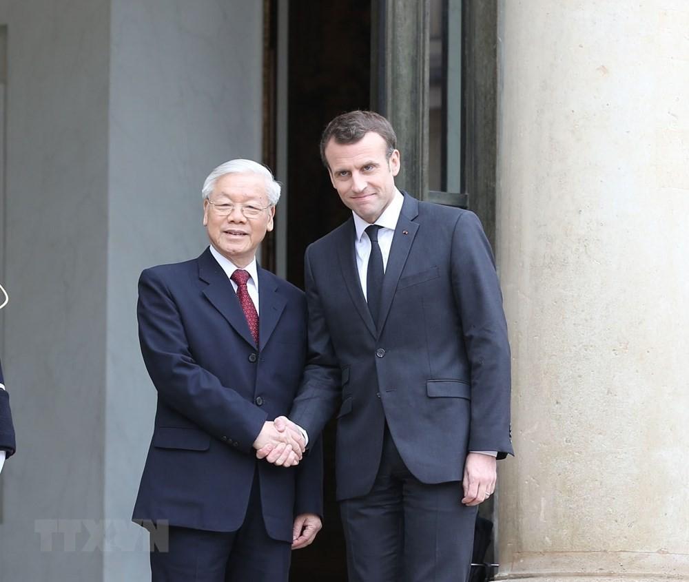 Tổng Bí thư Nguyễn Phú Trọng và Tổng thống Emmanuel Macron. Ảnh: TTXVN