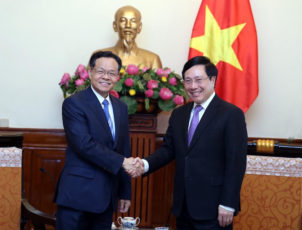Phó Thủ tướng Phạm Bình Minh tiếp Chủ tịch Khu tự trị dân tộc Choang Quảng Tây. Ảnh: VGP