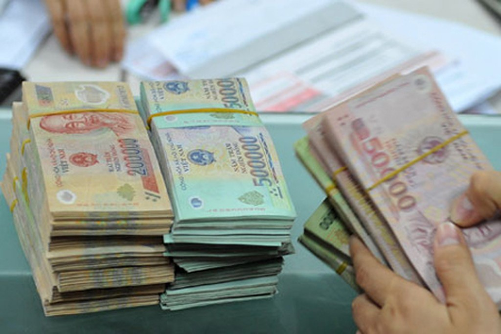 Chính phủ đề xuất chế độ tiền lương mới cho khu vực công sẽ được thực hiện từ năm 2021. Ảnh: PV