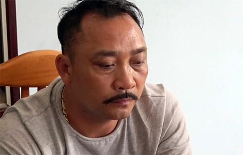 """""""Ông trùm"""" gỗ lậu Phan Hữu Phượng tại cơ quan điều tra. Ảnh: CAND."""