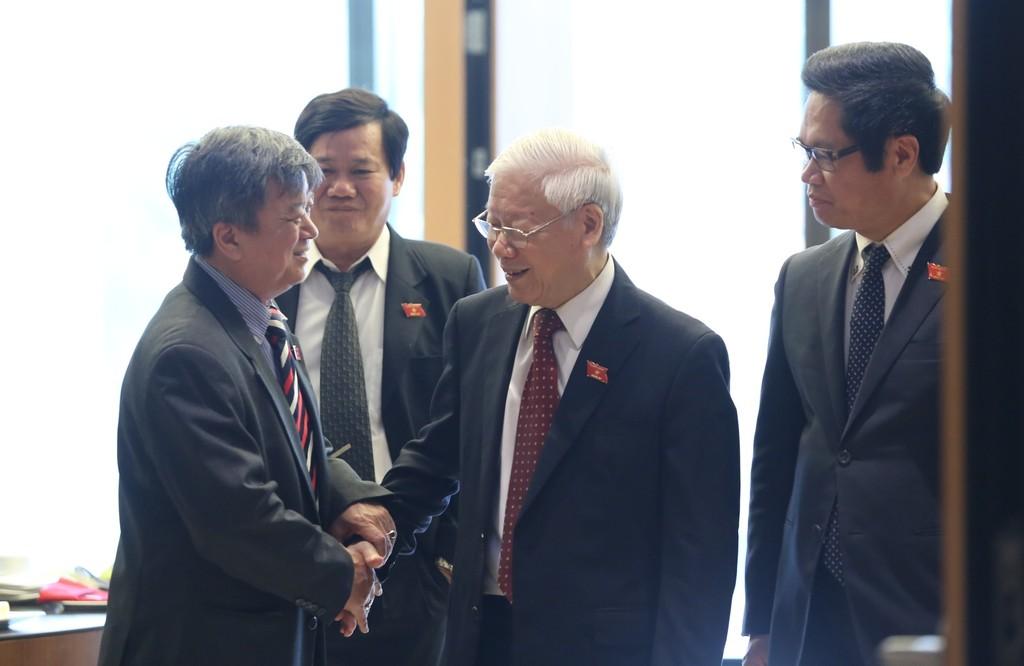 Tổng Bí thư Nguyễn Phú Trọng cùng các đại biểu dự phiên khai mạc kỳ họp Quốc hội. - Ảnh: VGP