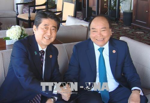 Thủ tướng Nguyễn Xuân Phúc gặp Thủ tướng Nhật Bản Shinzo Abe.