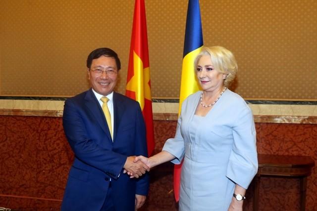 Phó Thủ tướng Phạm Bình Minh lần đầu tiên thăm Romania - ảnh 4