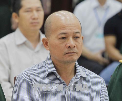 Bị cáo Đinh Ngọc Hệ, nguyên Phó Tổng giám đốc Tổng Công ty Thái Sơn (Bộ Quốc phòng) tại phòng xét xử. Ảnh: TTXVN