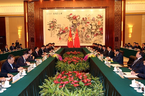 Phó Thủ tướng Vương Đình Huệ hội đàm với Phó Thủ tướng Trung Quốc - ảnh 1