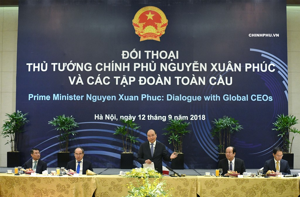 Thủ tướng đối thoại với các tập đoàn toàn cầu. Ảnh: VGP