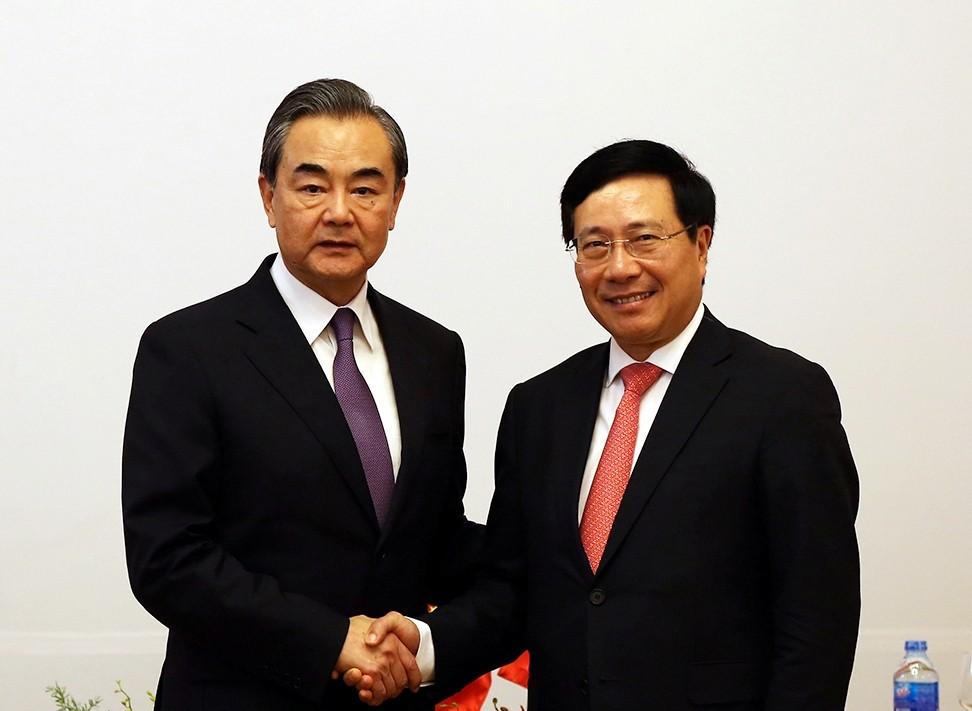 Phó Thủ tướng Chính phủ, Bộ trưởng Ngoại giao Phạm Bình Minh và Ủy viên Quốc vụ, Bộ trưởng Ngoại giao Trung Quốc Vương Nghị. Ảnh VGP