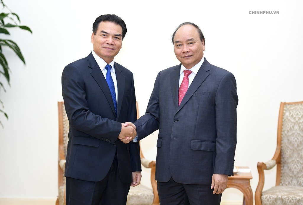 Thủ tướng Nguyễn Xuân Phúc tiếp Bộ trưởng, Chủ nhiệm Văn phòng Phủ Thủ tướng Lào Phet Phomphiphak. Ảnh: VGP