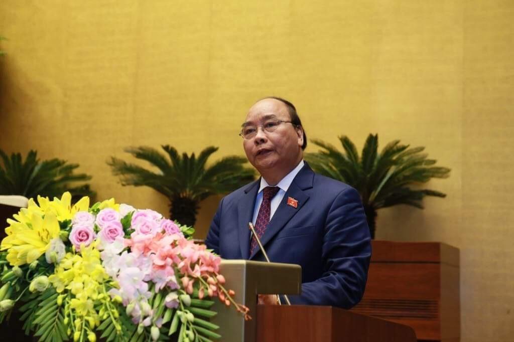 Thủ tướng Nguyễn Xuân Phúc trình bày báo cáo trước Quốc hội về tình hình KTXH 2018 - Ảnh: VGP