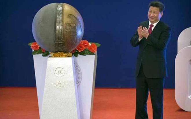 Chủ tịch Trung Quốc Tập Cận Bình tại lễ khai trương AIIB sáng 16/1 - Ảnh: Reuters.