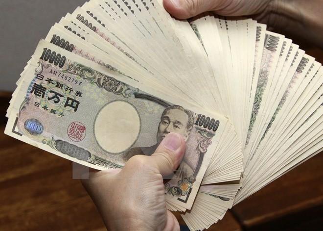 Những tờ tiền mệnh giá 10.000 yen tại Tokyo, Nhật Bản. (Nguồn: AFP/TTXVN)