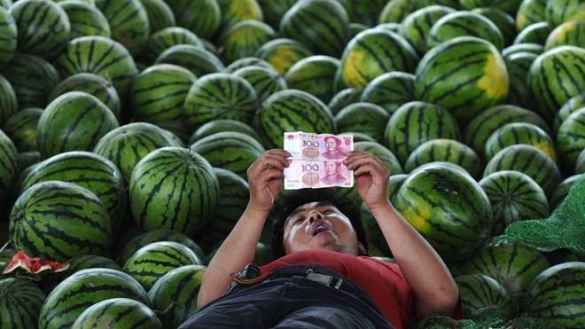 Barclays: Trung Quốc cần hạ giá nhân dân tệ tới 25%