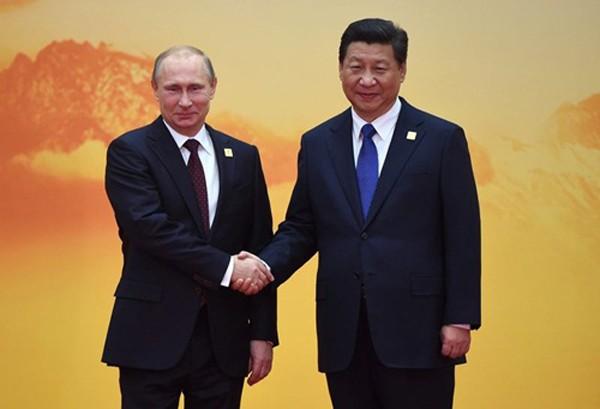 Tổng thống Nga Vladimir Putin gặp Chủ tịch Trung Quốc Tập Cận Bình tại Bắc Kinh hồi năm 2014. Ảnh: AFP