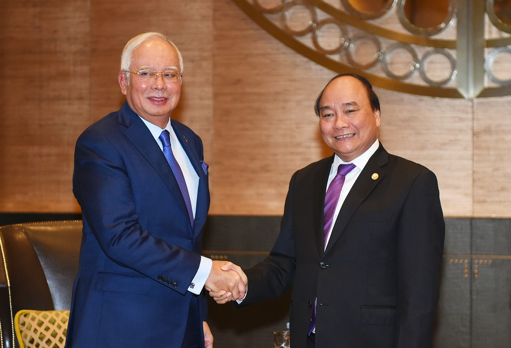 Thủ tướng Nguyễn Xuân Phúc và Thủ tướng Malaysia Najib Razak. Ảnh: VGP/Quang Hiếu