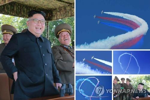Nhà lãnh đạo Triều Tiên theo dõi cuộc thi của các máy bay chiến đấu hôm 4/6 (Ảnh: Yonhap)