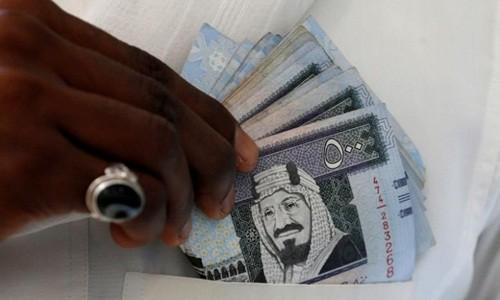 Đồng riyadh của Qatar đã xuống đáy 11 năm hôm qua. Ảnh:Reuters