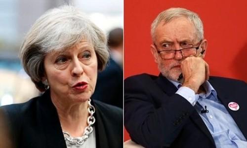 Bà Theresa May (trái) và ông Jeremy Corbyn. Ảnh:Reuters.
