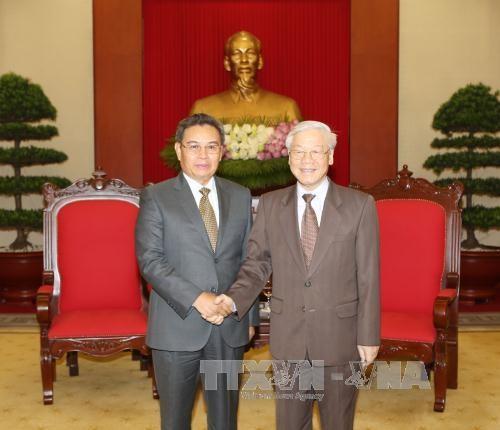 Tổng Bí thư Nguyễn Phú Trọng và đồng chí Saysomphone Phomvihane, Ủy viên Bộ Chính trị Đảng Nhân dân Cách mạng Lào, Chủ tịch Ủy ban Trung ương Mặt trận Lào Xây dựng đất nước. Ảnh: TTXVN