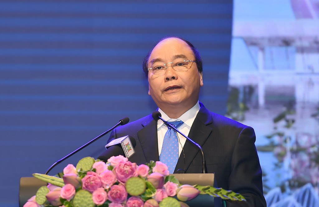 Thủ tướng Nguyễn Xuân Phúc biểu dương hành động kiến tạo của lãnh đạo Hà Nội. Ảnh: VGP/Quang Hiếu