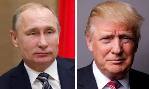 Tổng thống Nga Vladimir Putin (trái) và người đồng cấp Mỹ Donald Trump. Ảnh:Reuters.
